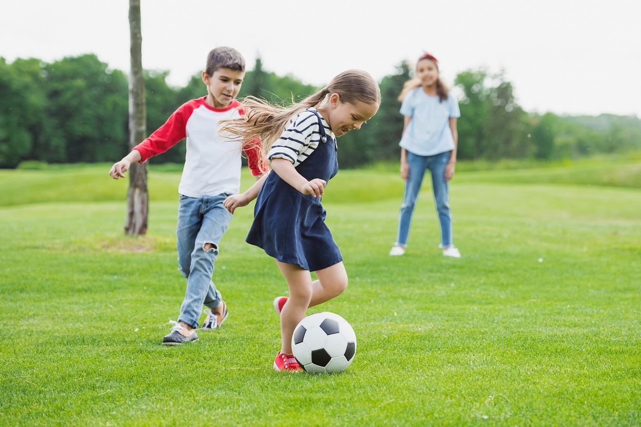 A picture of children playing with a football