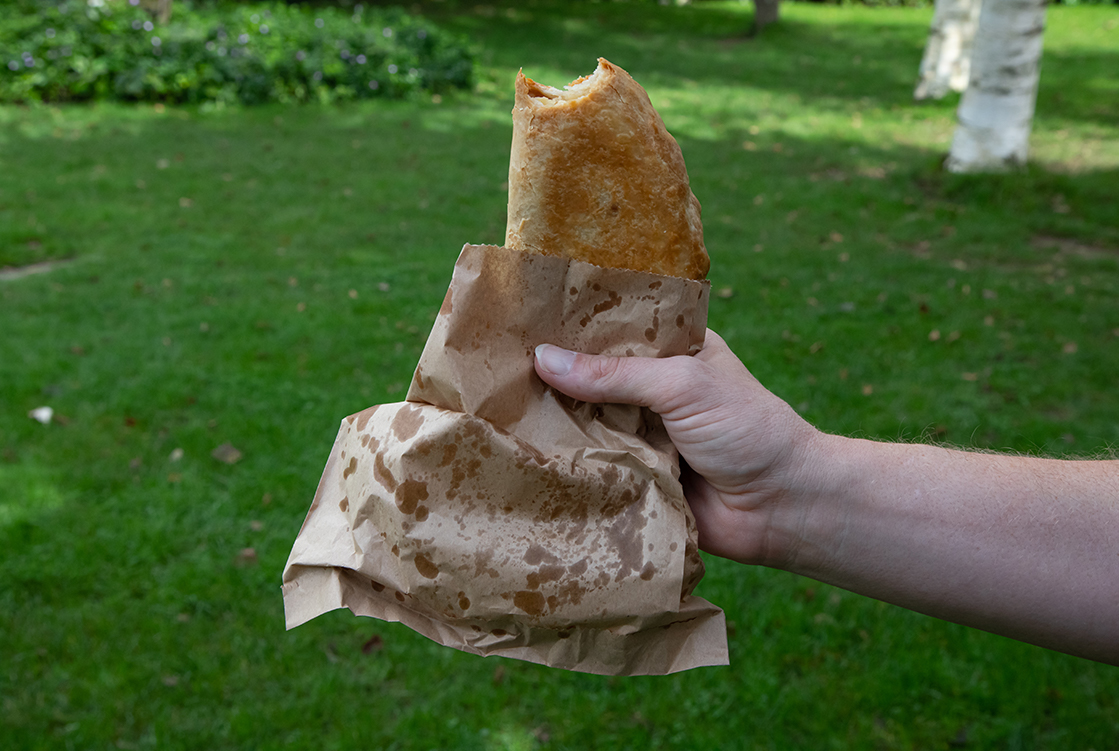Pasty in a takeaway bag