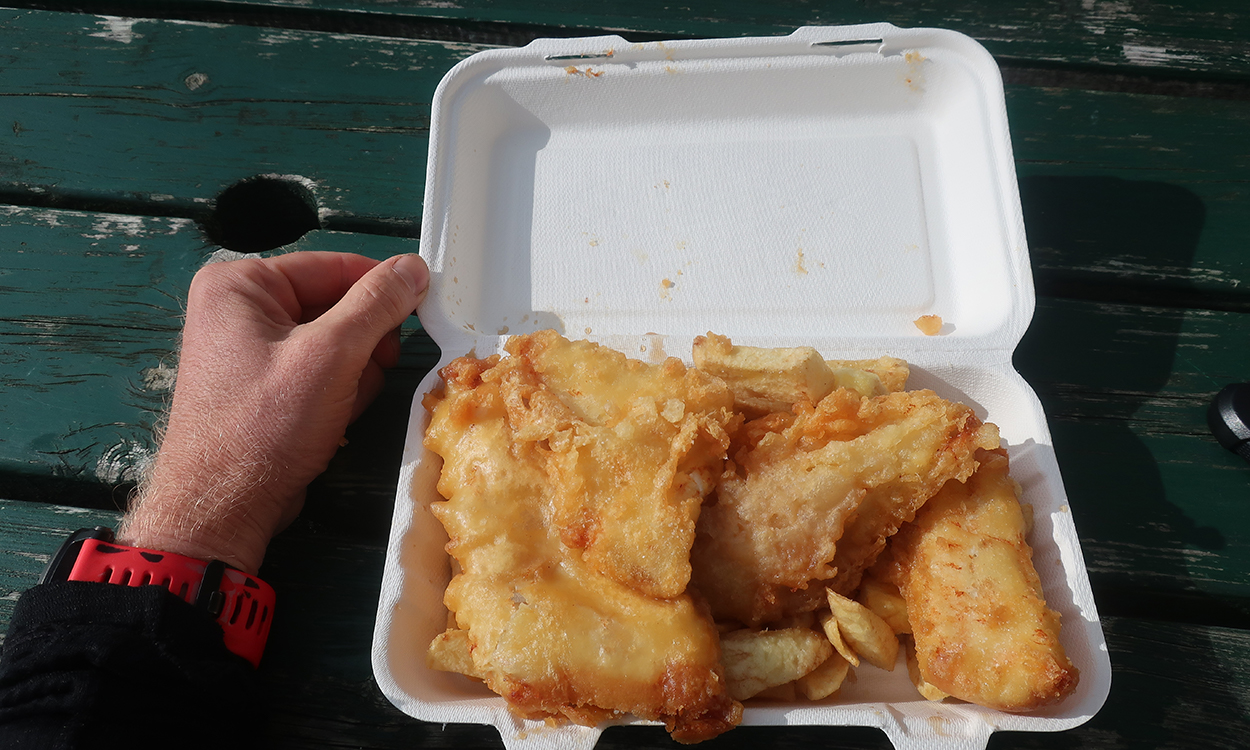 Fish and chips in a takeaway box